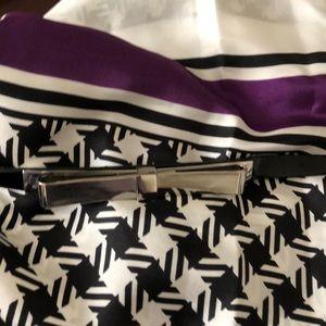 Adjustable belt with bow tie.